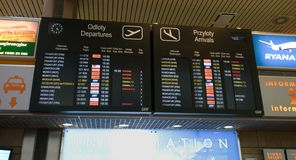 Airport Departures Board in Krakow airport Stock Photos