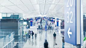Airport Departures terminal. Time lapse people rushing through airport departure hall
