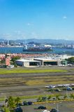 Airport and dock I. View of airport and dock with sea Royalty Free Stock Images