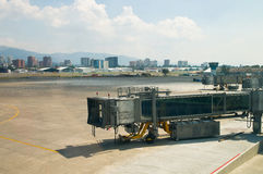 Airport - dockingstation. Airport guatemala city - landing field and gangways with the cityskyline in the background Stock Photo