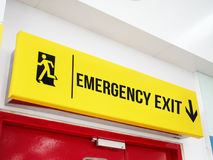 Airport Emergency Exit Signage. Above the Red Door Royalty Free Stock Photos