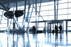 Airport Entrance. People silhouettes entering airport lounge with luggage stock images