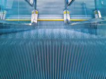 Airport Escalator. An airport escalator from the top landing showing motion blur Stock Image