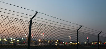 Airport evening fence background Stock Image