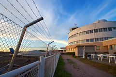 Airport fence. Small plane airport security fence and traffic control building in Malmi, Helsinki, Finland Royalty Free Stock Photography