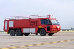 Airport fire engine. Red airport fire engine, emergency vehicle with extinguishing devices Royalty Free Stock Photo