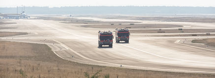 Airport fire trucks. Two plain airport fire trucks Royalty Free Stock Photos