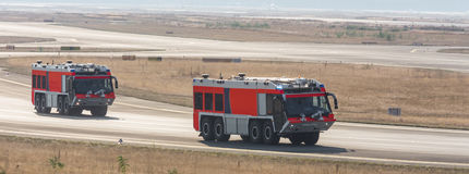 Airport fire trucks. Two plain airport fire trucks Royalty Free Stock Images