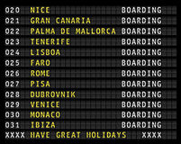 Airport flight information display,holiday destinations Stock Photos