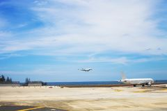 Airport with flying airplane in Phuket, Thailand. Airport near beach of Andaman sea royalty free stock photos