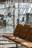 Airport gate and chairs in waiting hall Stock Image