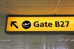 Airport gate signs. Generic airport signage in London Heathrow. Illuminated gates sign stock image