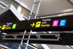 Airport gate signs, Malaga airport. Royalty Free Stock Images