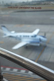 Airport Glass with plane in background Stock Photography