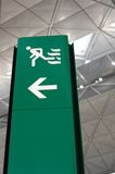 Airport green exit sign Stock Image