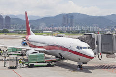 Airport ground handing operations and load up luggages  on tarma. C  in Taipei SongShan Airport Royalty Free Stock Photography