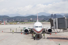 Airport ground handing operations on tarmac  in Taipei SongShan Stock Image