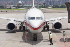 Airport ground handing operations on tarmac in Taipei SongShan A. Irport Stock Images