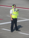Airport ground staff on the runway Stock Photos