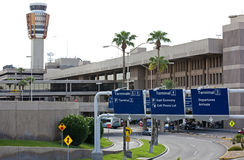 Airport Ground Transportation. Major airport showing forms of ground transportation including road, bridges, ramps, parking, signs, auto and control tower Stock Image