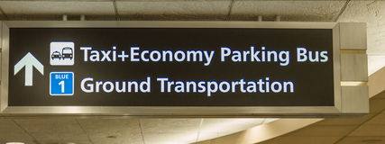 Airport Ground Transportation Sign. An airport ground transportation sign for passengers leaving airport terminal Stock Images