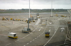 Airport ground vehicles ready for an airplane Royalty Free Stock Image