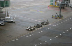 Airport ground vehicles ready for an airplane Royalty Free Stock Photo