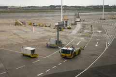 Airport ground vehicles ready for an airplane Royalty Free Stock Images