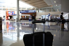 Airport Hall. A bag sits in an airport hall, awaiting boarding - an image all Road Warriors will recognise Stock Photo