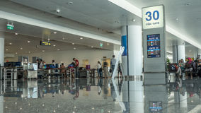 Airport hall with people in security checkpoint. Hanoi, Vietnam Royalty Free Stock Photography