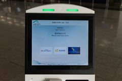 Airport, Hong Kong - CIRCA April,2018: self service transfer area doing self check in kiosk machines royalty free stock image