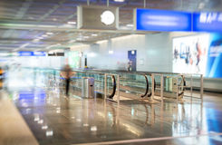 Airport interior with escalator. Royalty Free Stock Photo