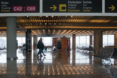 Airport interior with information signs. AIRPORT, PALMA DE MALLORCA, SPAIN - APRIL 24, 2015: Airport interior with information signs and people reflected in stock images