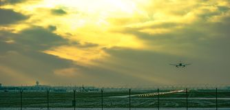 Airport landscape landing plane at sunset stock photography