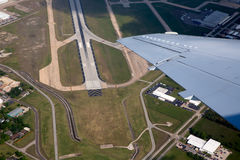 Airport lannding road view from aerial view. Airport landing road view from aerial view and aircraft wing Royalty Free Stock Images