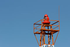 Airport light beacon. Light beacon at a small airport against clear blue sky Stock Image