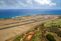 Airport of Lihue, Kauai. Aerial view towards the coastline over the airport of Lihue, Kauai, Hawaii, USA royalty free stock photo