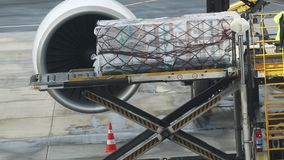 An airport - loading the baggage in the plane