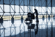 Airport lobby. Cleaning staff in an airport hall royalty free stock images