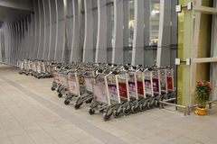 Airport luggage cart Stock Images