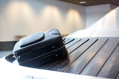 Airport luggage claim. Large suitcase in the airport luggage claim area royalty free stock photo