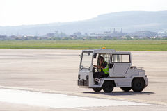 Airport luggage towing vehicle Royalty Free Stock Photos