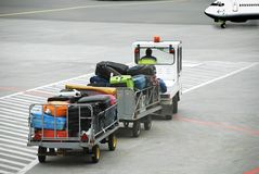 Airport, Luggage traffic on  to the plane Royalty Free Stock Photo