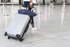Airport luggage Trolley with suitcases, unidentified man woman walking in the airport, station, France. Stock Images