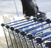Airport luggage trolleys for baggage Stock Images