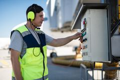 Airport mechanic checking technical equipment stock photography