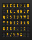 Airport Mechanical Flip Board Panel Font. Yellow/Orange Font on Dark Background Vector Illustration Royalty Free Stock Photography