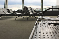 At the airport. Metal seats at the airport waiting area Stock Images