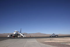Airport in the Middle of Nowhere. Airplane landed in the deserts of Atacama Royalty Free Stock Image