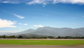 Airport in mountains. Small airport in mountains at spring stock image